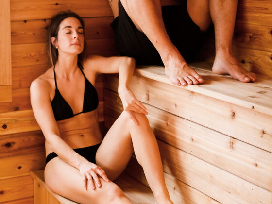Couple relaxing getaway sauna AX hotel